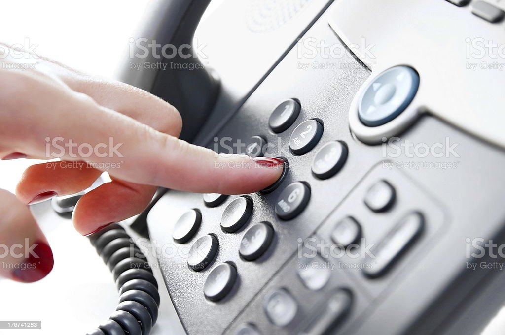 Female hand dialing a phone number stock photo