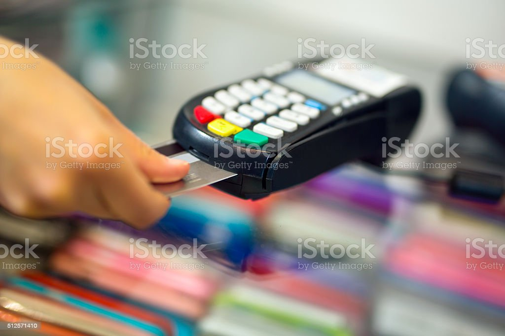 Female hand doing purchase through payment machine stock photo