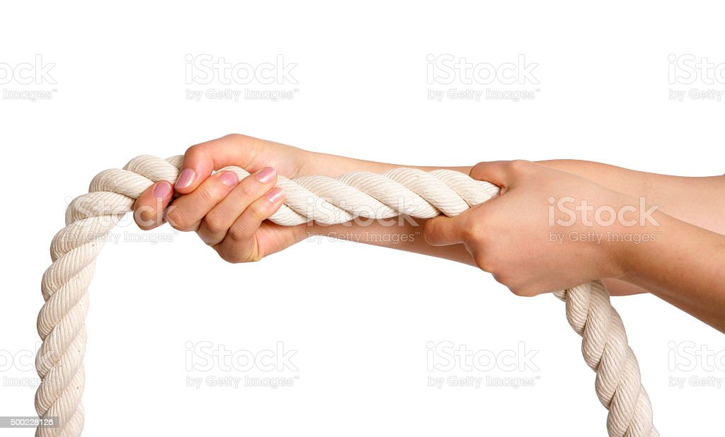 Female hand gripping a rope stock photo