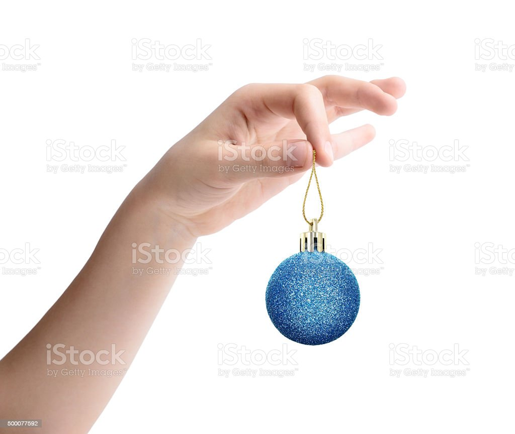 Female hand holding a Christmas toy isolated on white background stock photo