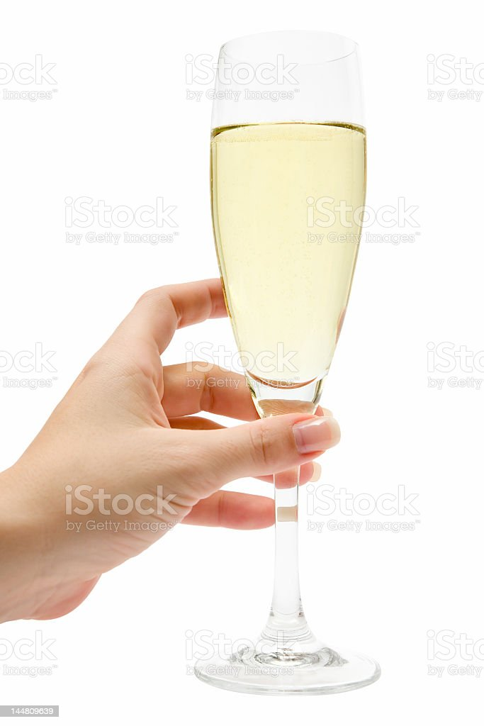 A female hand holding a glass of Champagne royalty-free stock photo