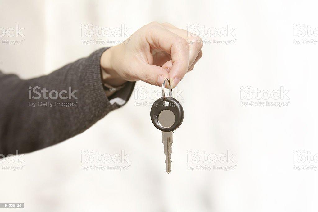Female hand holding a key stock photo