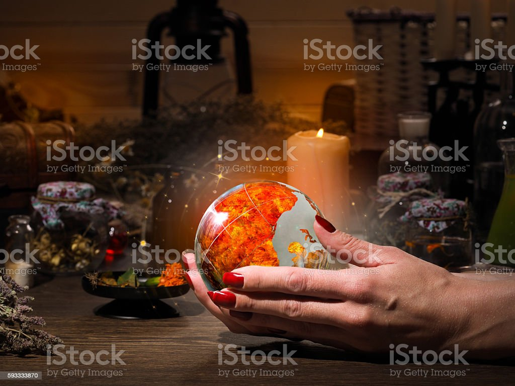 Female hand holding a magical fiery sphere. stock photo