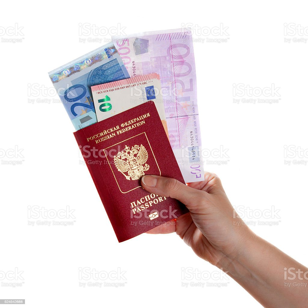 female hand holding a passport with Euro banknotes stock photo