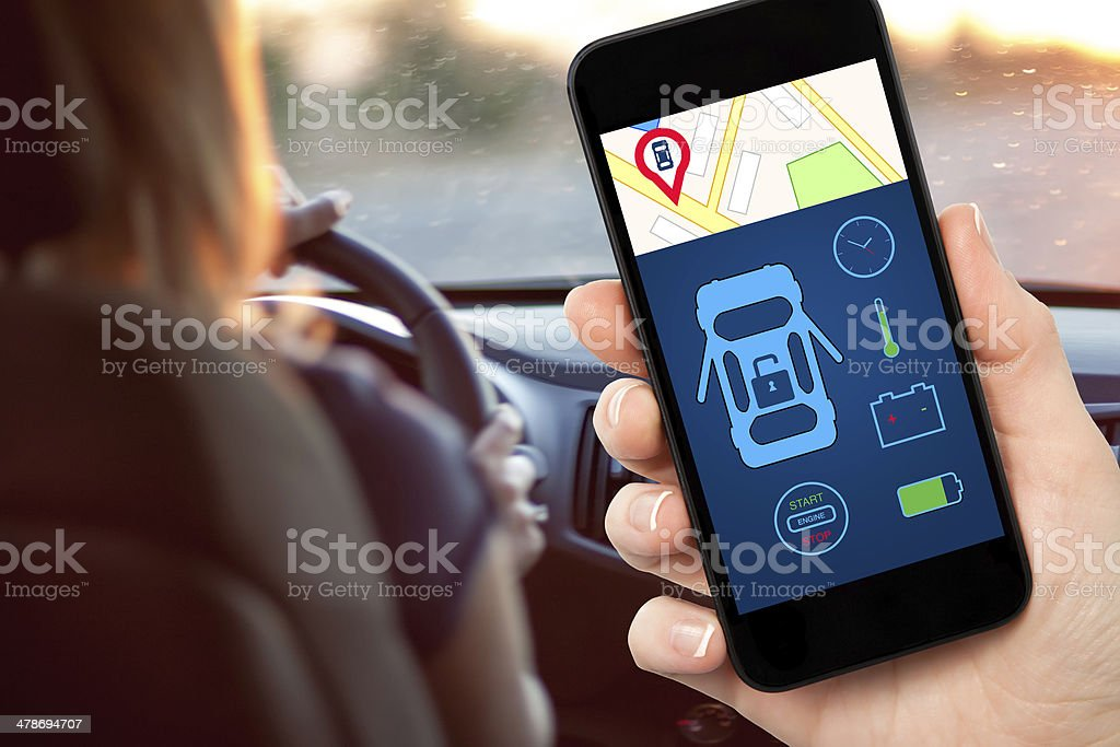 female hand holding a phone with interface auto alarm stock photo