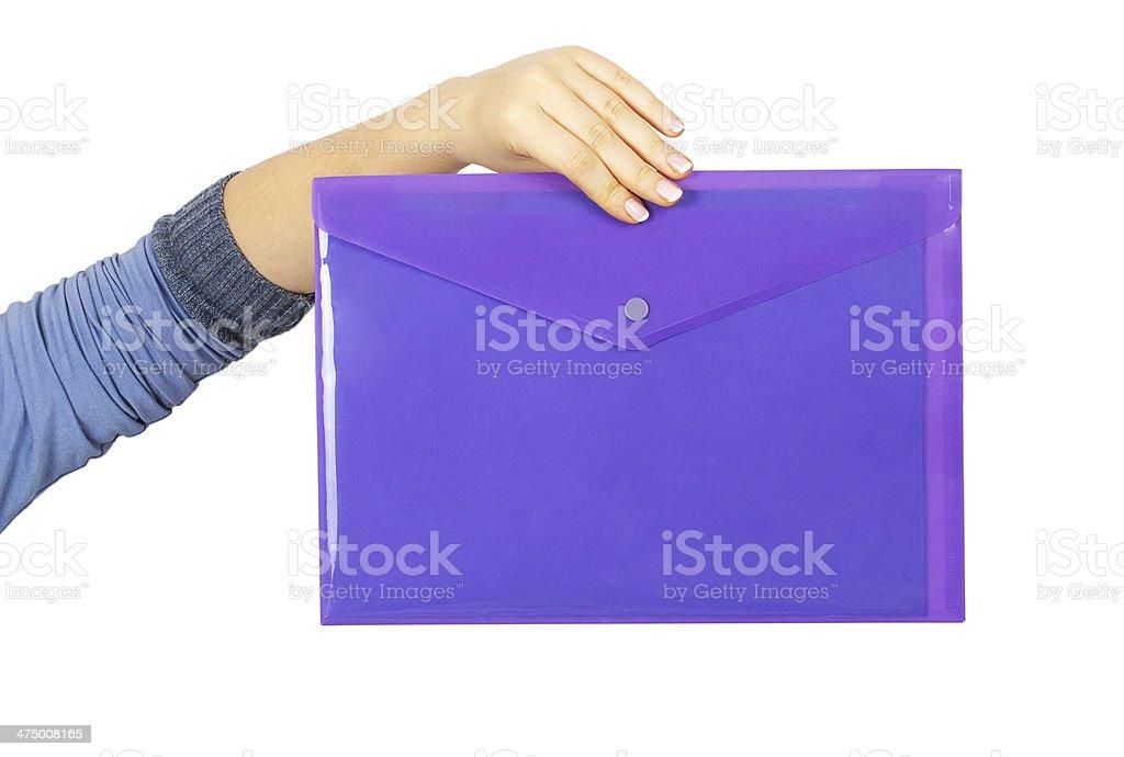 Female hand holding a purple plastic folder royalty-free stock photo