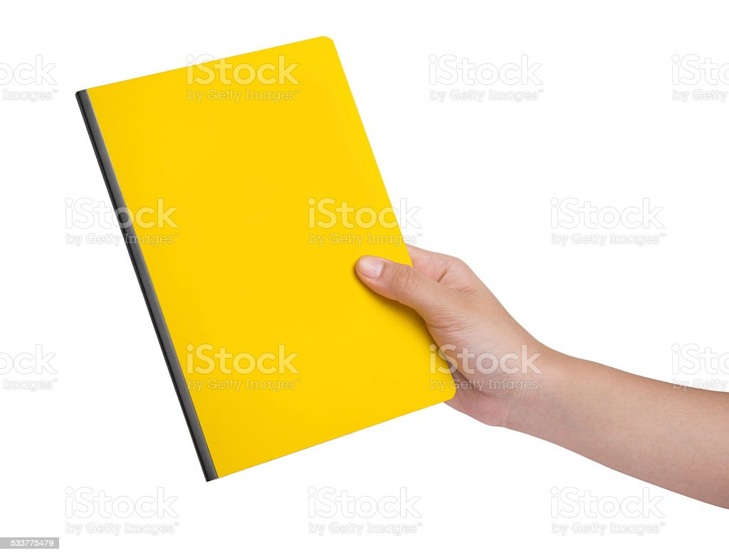 Female hand holding a yellow book stock photo