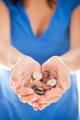 female hand holding american coins