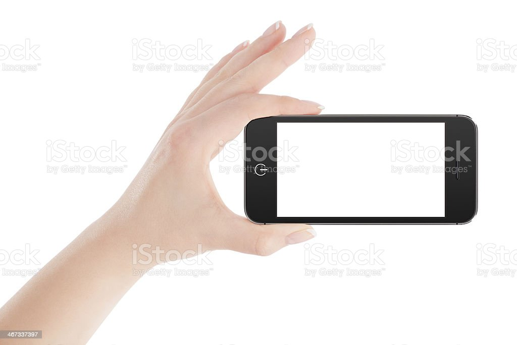 Female hand holding black smart phone in landscape orientation stock photo