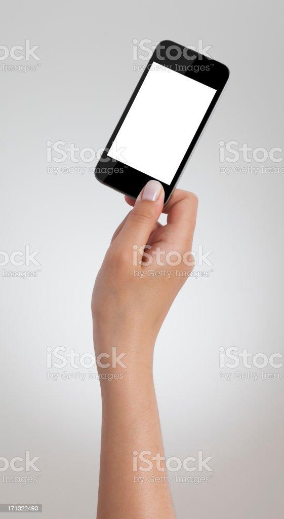 Female hand holding black smart phone stock photo
