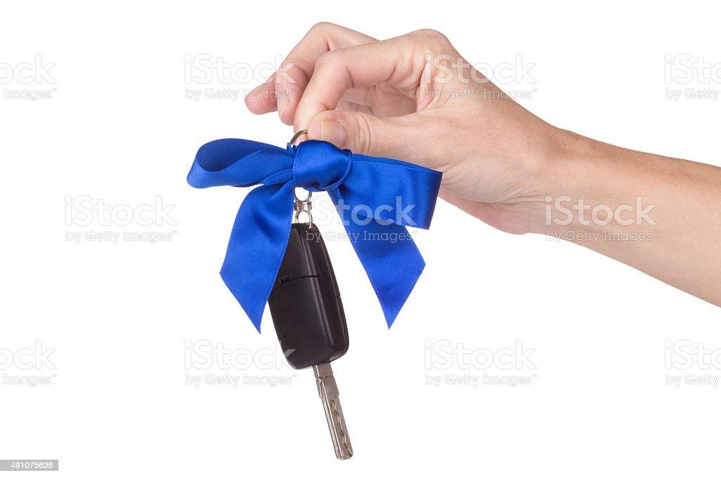 female hand holding car keys stock photo