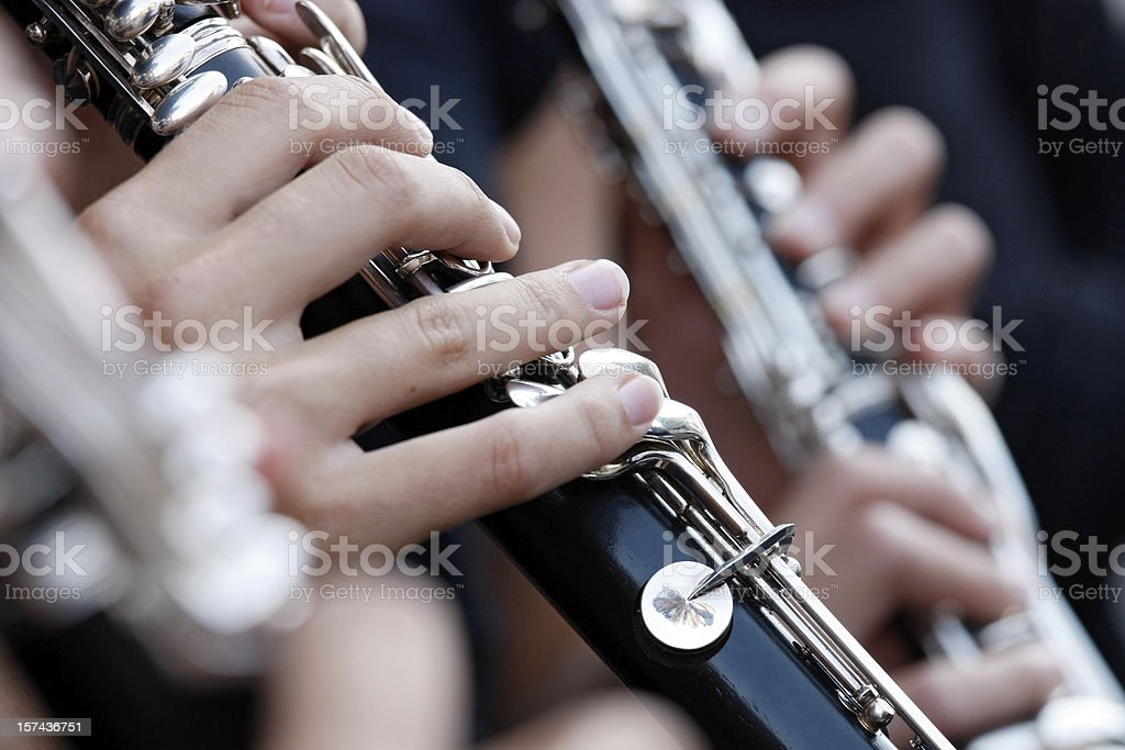 Female hand holding clarinet while playing in orchestra, close-up stock photo