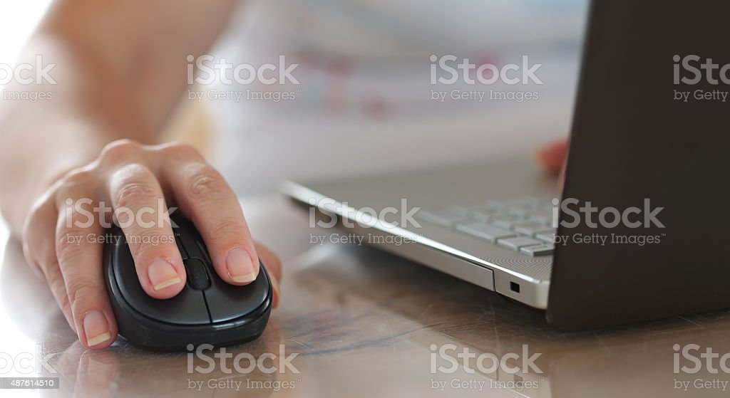Female hand holding computer wireless mouse stock photo
