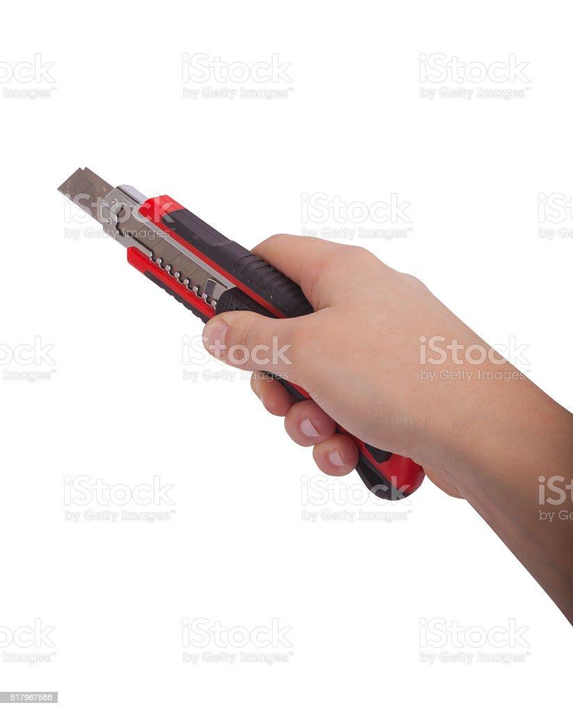 Female hand holding cutter knife, isolated on white background stock photo