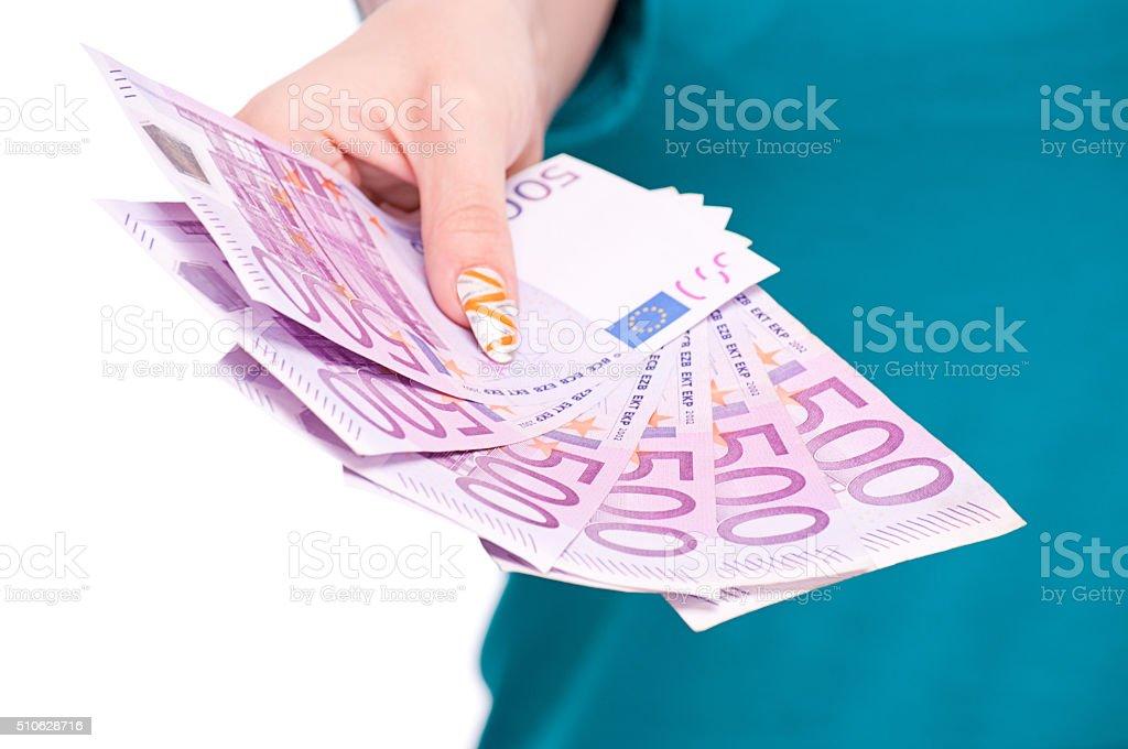 Female hand holding European banknotes stock photo