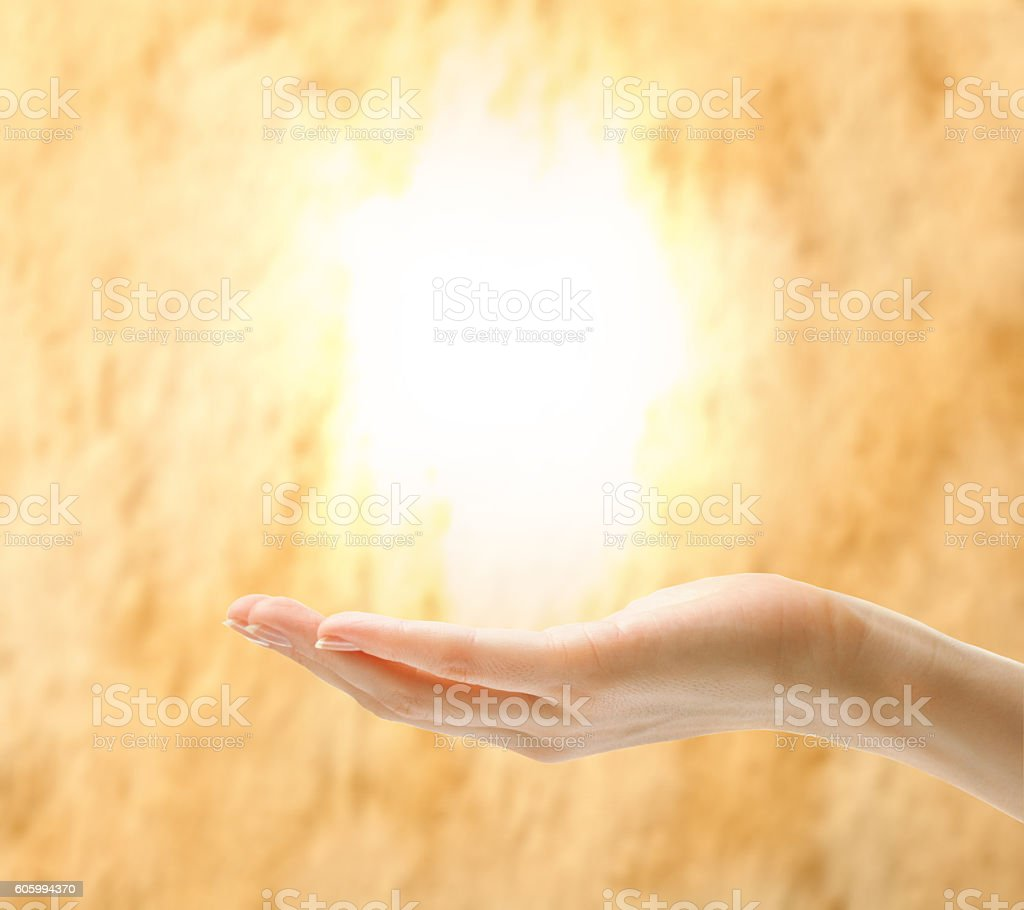 Female hand holding light stock photo