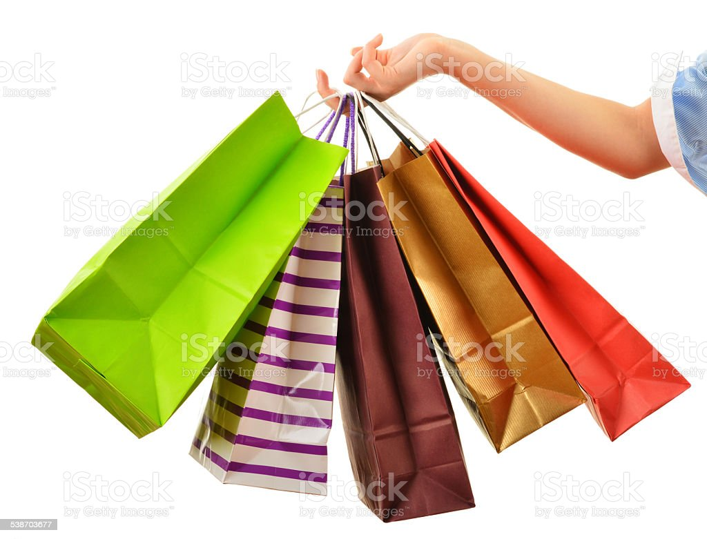 Female hand holding paper shopping bags isolated on white stock photo