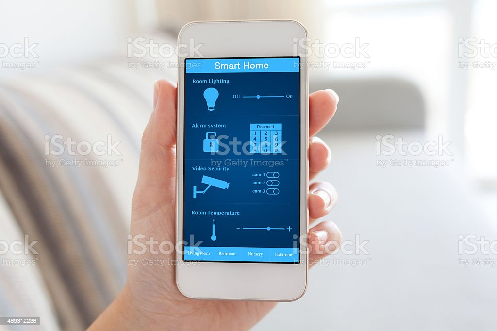 female hand holding phone with smart home on the screen stock photo