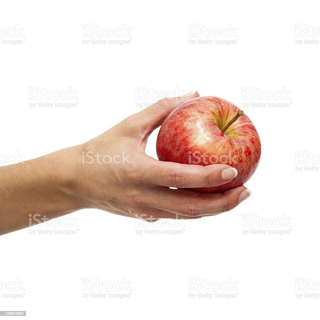 Femelle Main tenant la pomme rouge. photo libre de droits