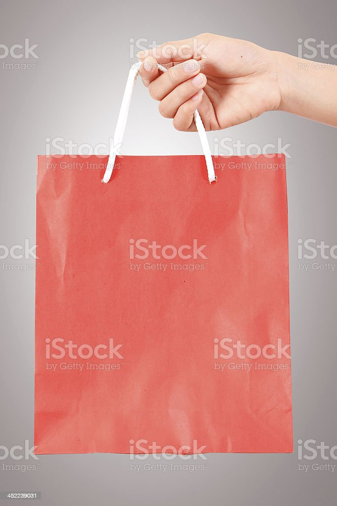female hand holding red bag  - shopping and holiday concept royalty-free stock photo