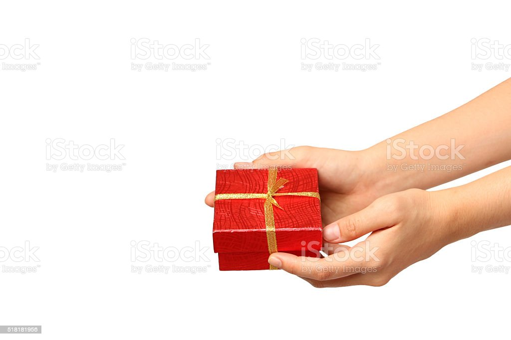 female hand holding red gift box with a gold ribbon stock photo