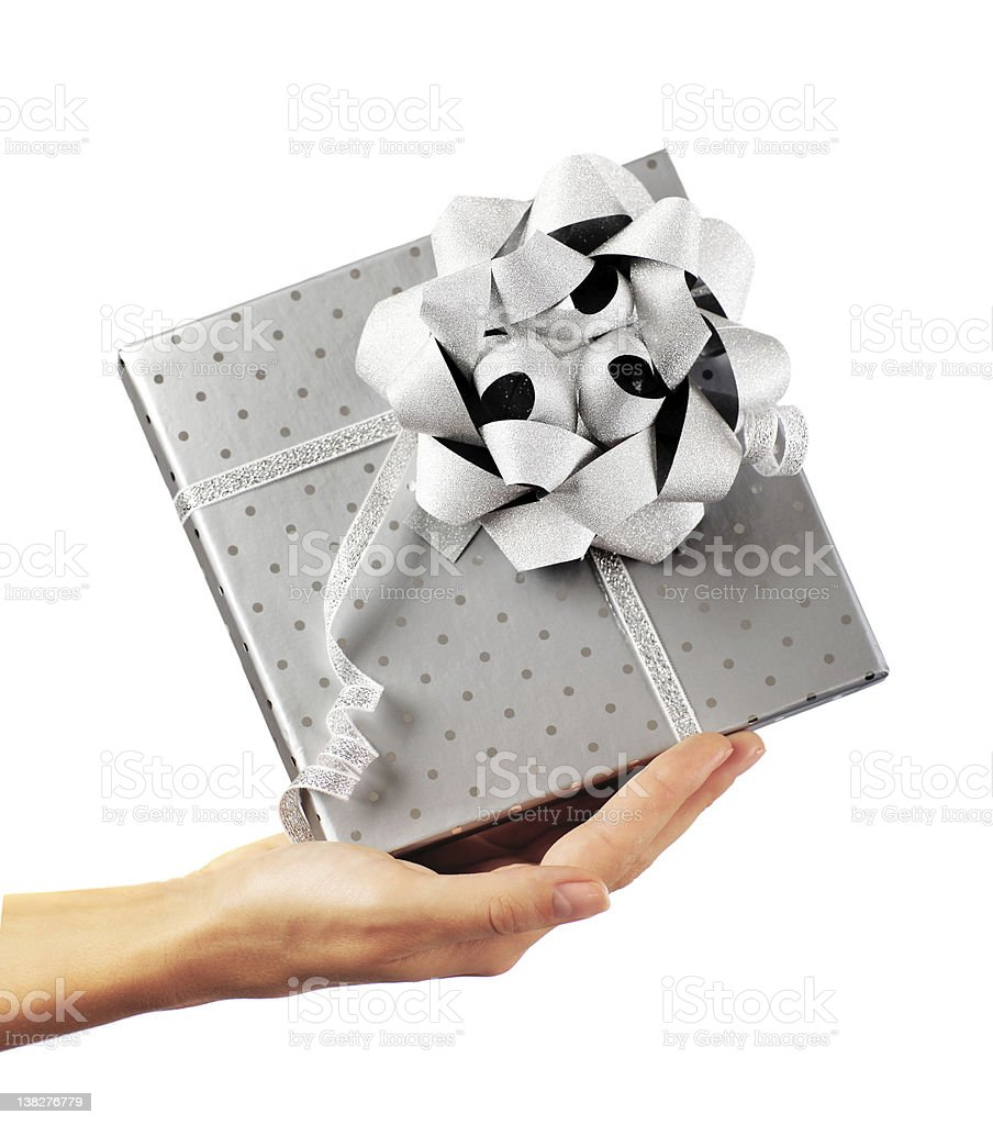 Female hand holding silver gift box royalty-free stock photo