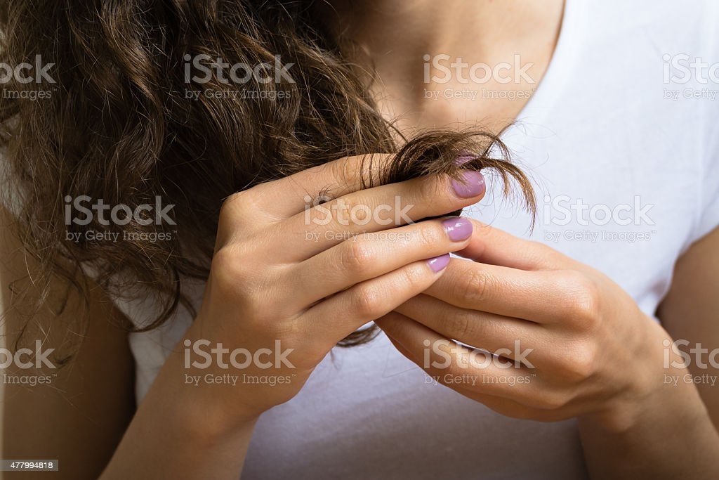 Female hand holding the hair ends stock photo