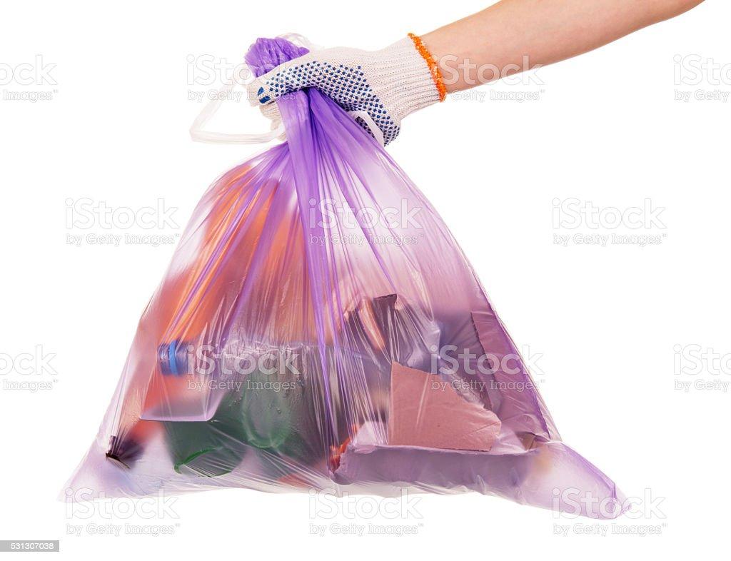Female hand holding  waste bag isolated on white stock photo