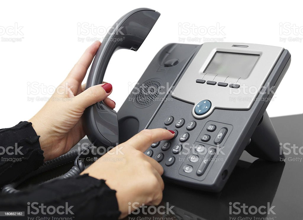 female hand is dialing a phone number stock photo