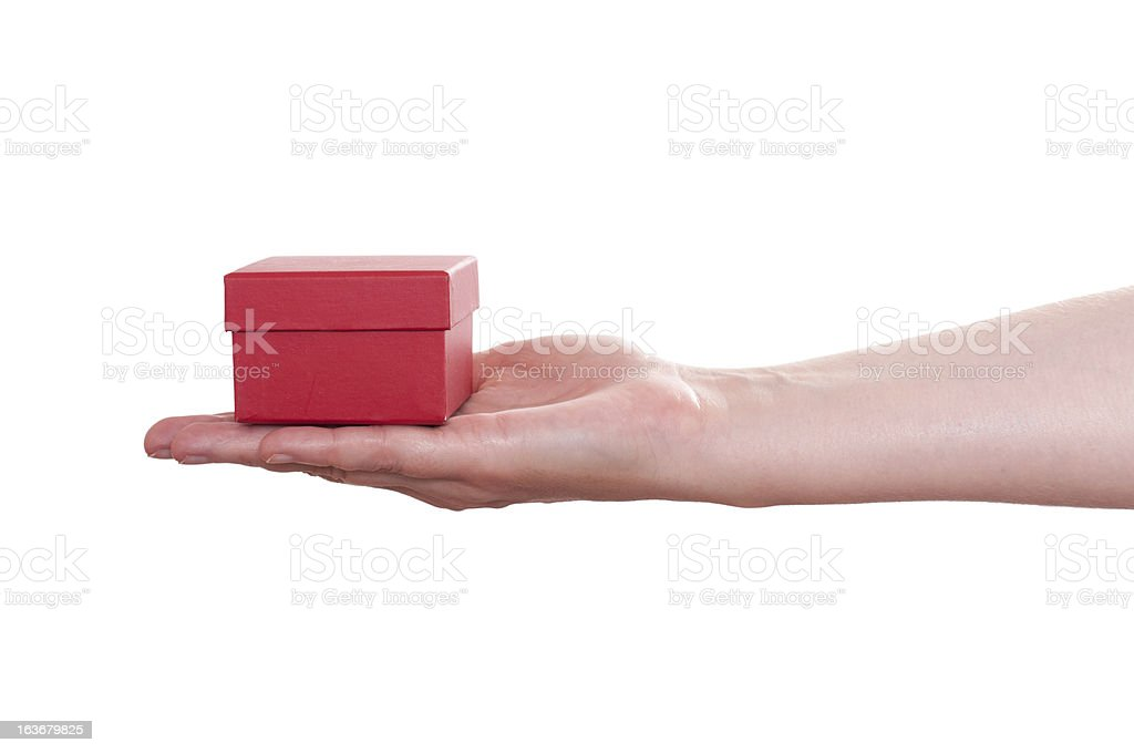 Female hand is holding a red gift box royalty-free stock photo