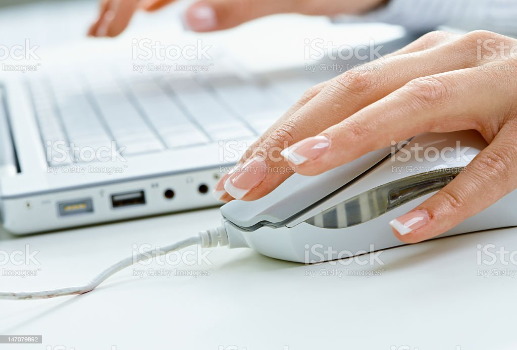 Female hand moving computer mouse royalty-free stock photo