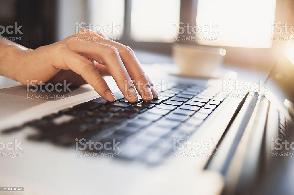 Female hand on a keyboard stock photo