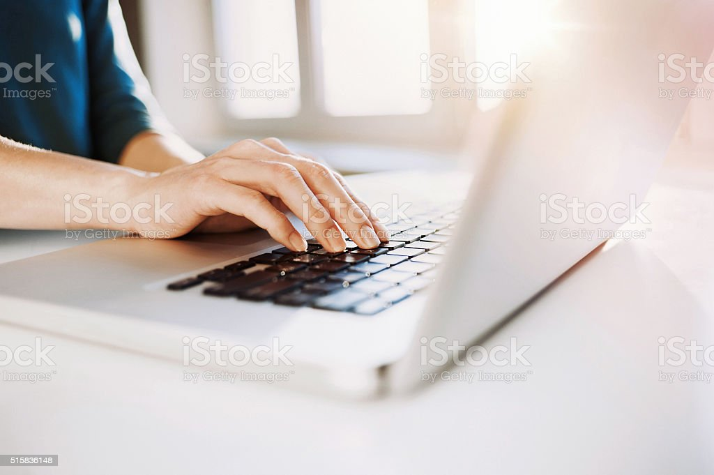 Female hand on a laptop keyboard stock photo