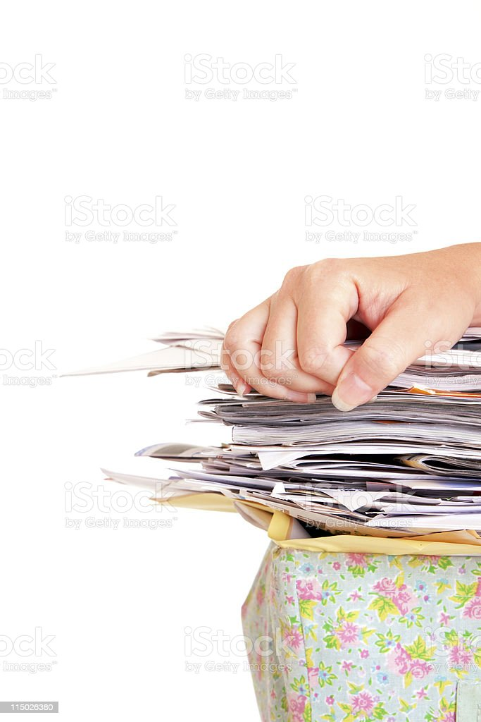 Female Hand on a Stack of Papers Magazines stock photo