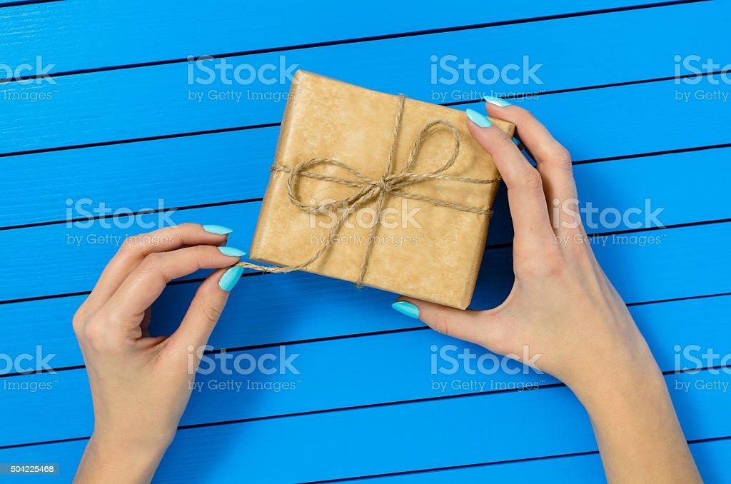 Female hand opening gift box stock photo