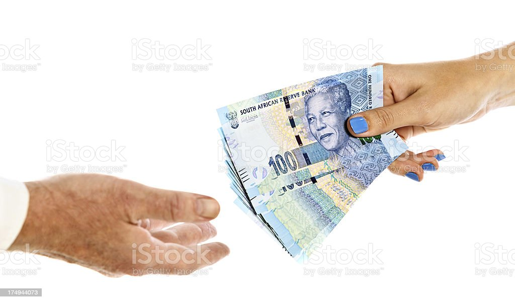 Female hand passing Hundred Rand banknotes to man stock photo