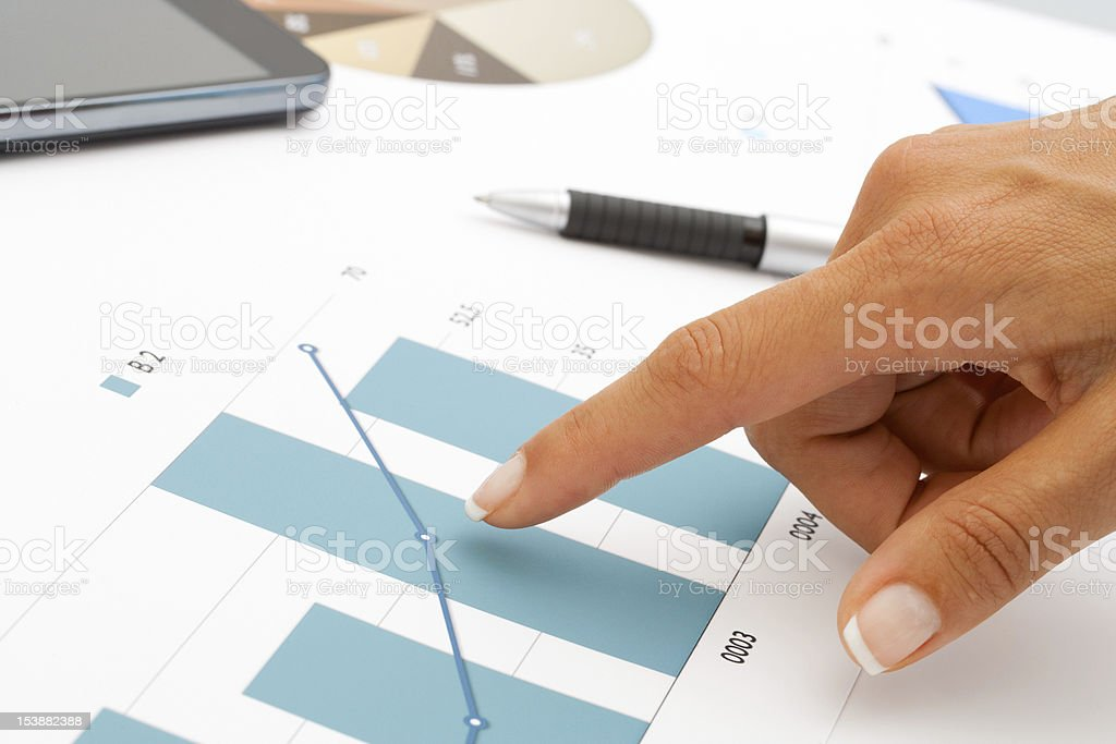 Female hand pointing at statistics. royalty-free stock photo