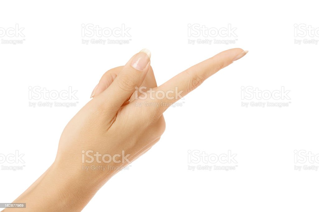 Female hand pointing upside down with index finger on white stock photo