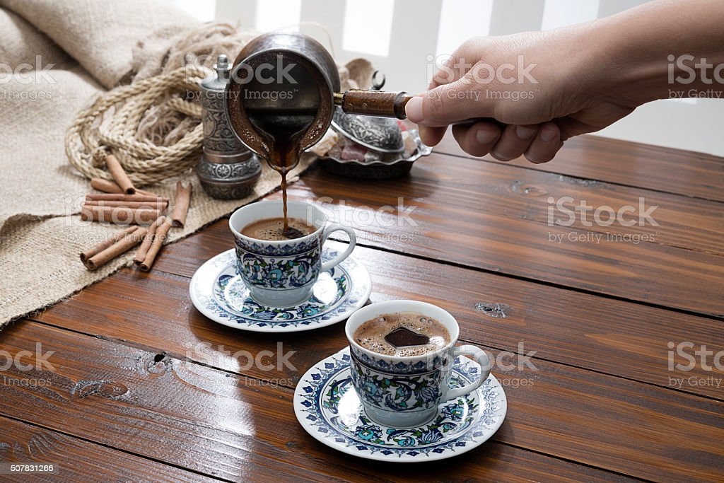 Female Hand Pouring Turkish Coffee stock photo