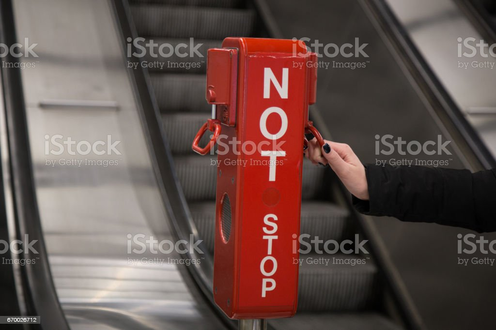 Female hand pulling emergency brake stock photo