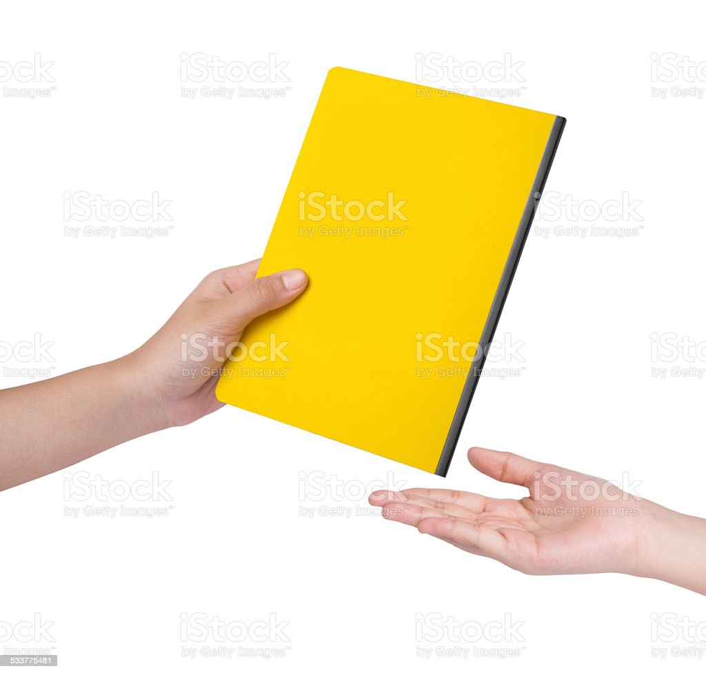 Female hand send a yellow book stock photo