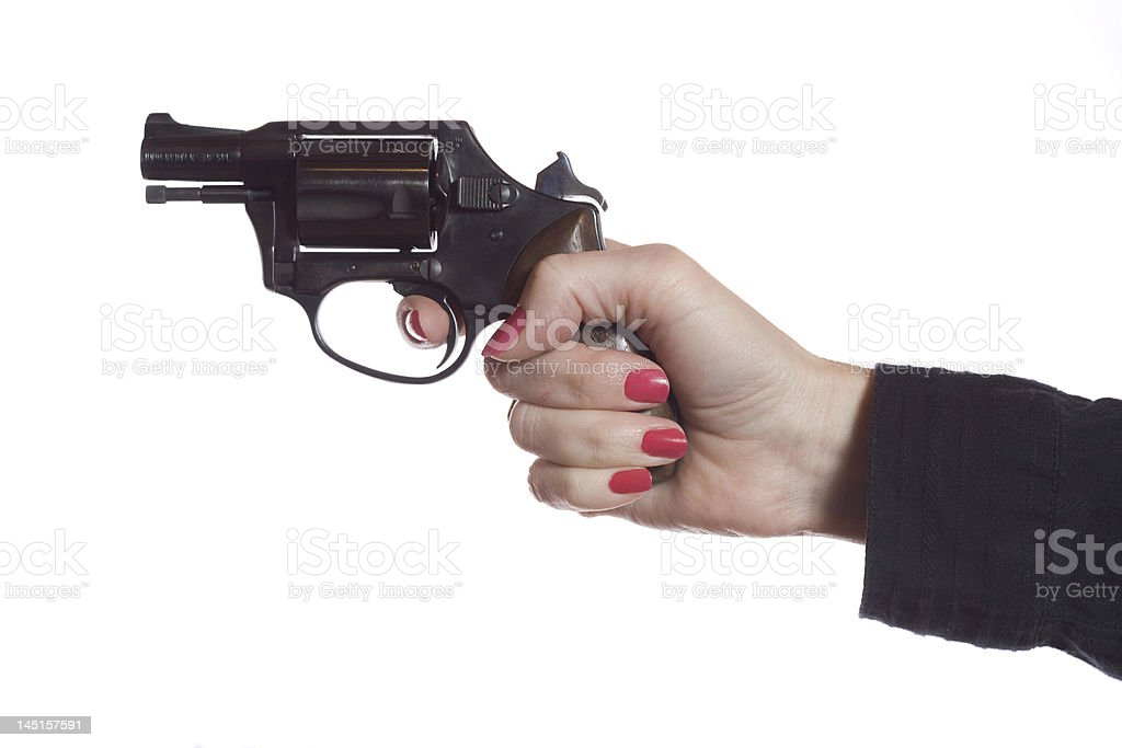 Female hand shooting a black revolver  royalty-free stock photo
