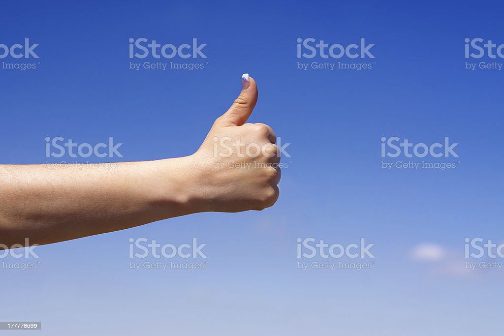 Female hand showing thumbs up royalty-free stock photo