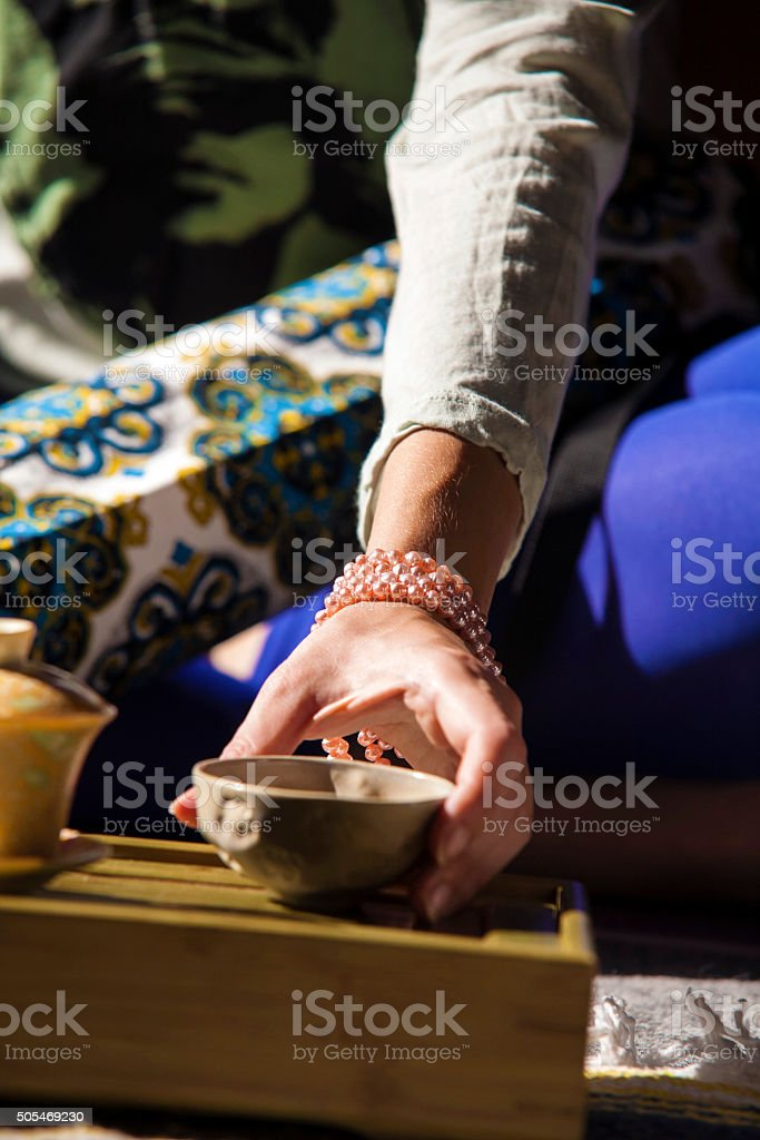 Female hand taking a cup with a tea stock photo