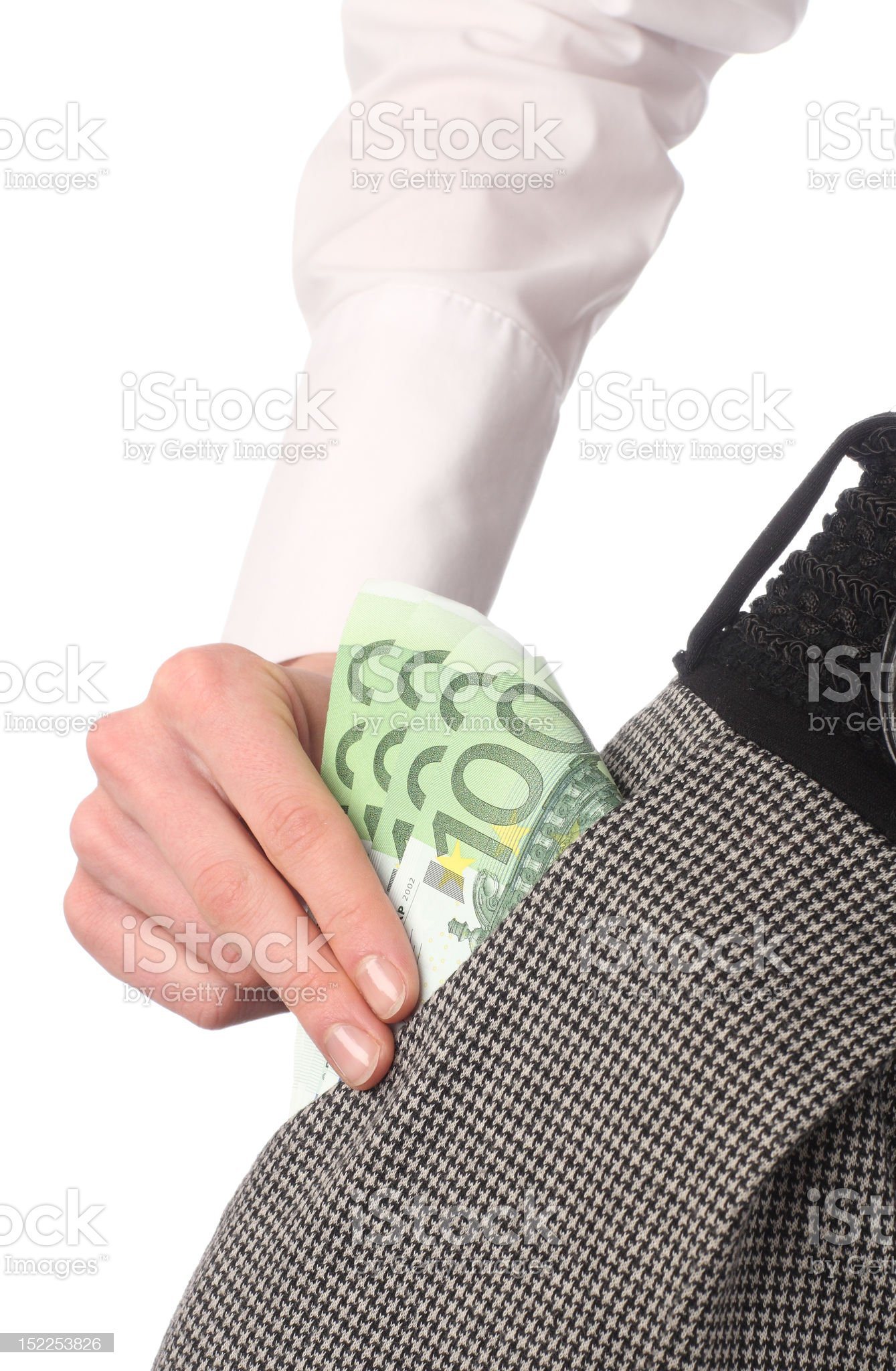 Female hand taking banknotes out from the pocket royalty-free stock photo