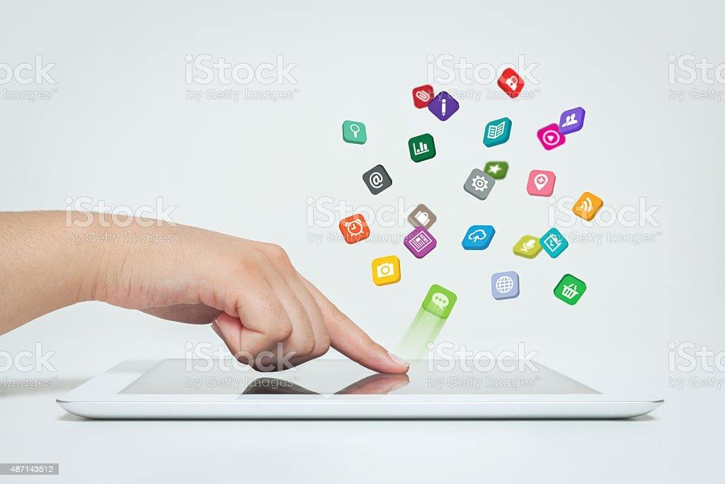 Female hand touching tablet computer icon. stock photo