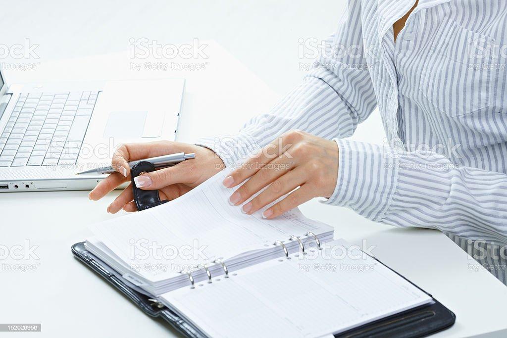 Female hand turning page stock photo