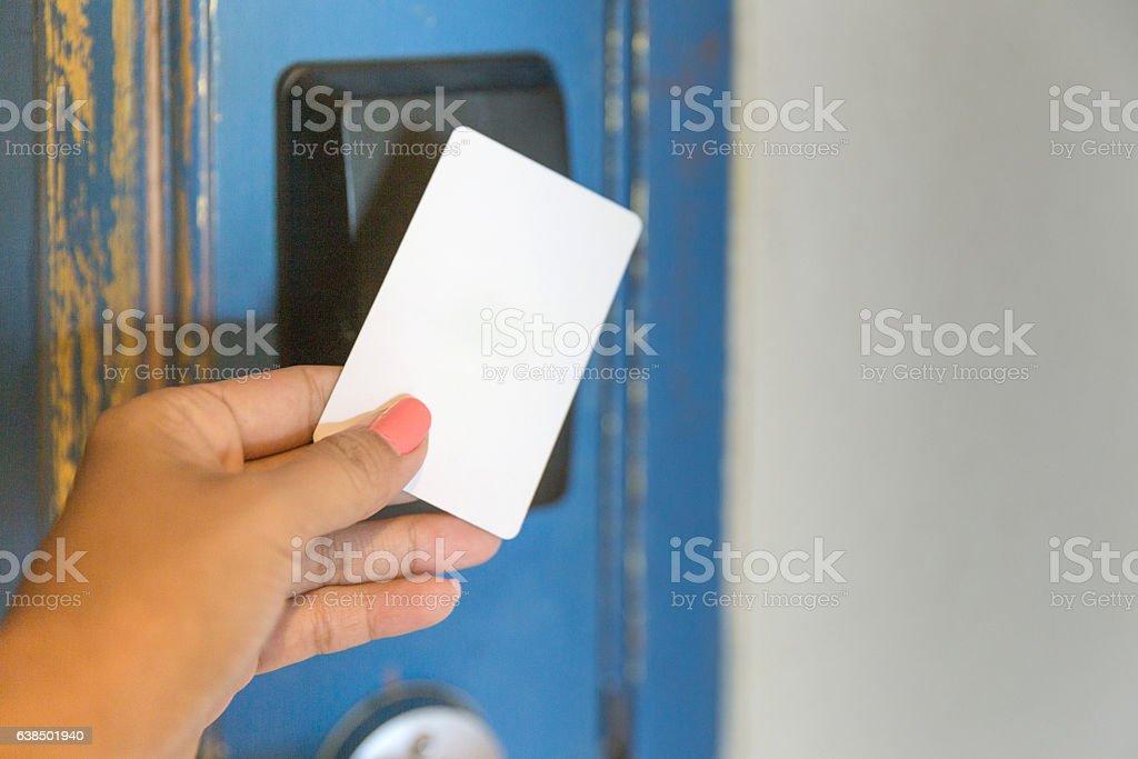 Female hand Unlocking Electronic Hotel Door Lock with Key Card stock photo
