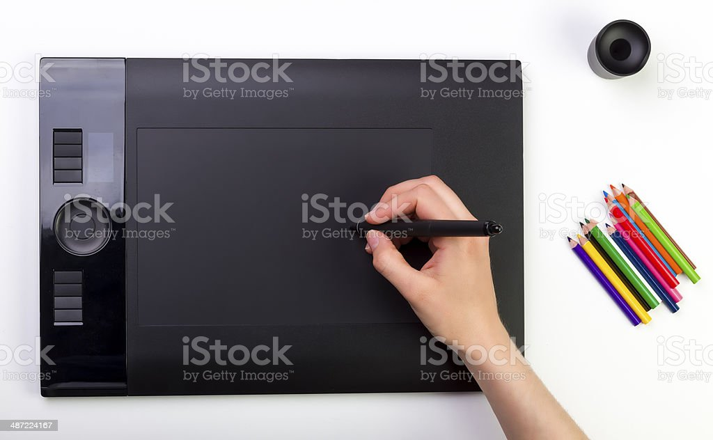 Female Hand Using Graphic Tablet. Creativity stock photo