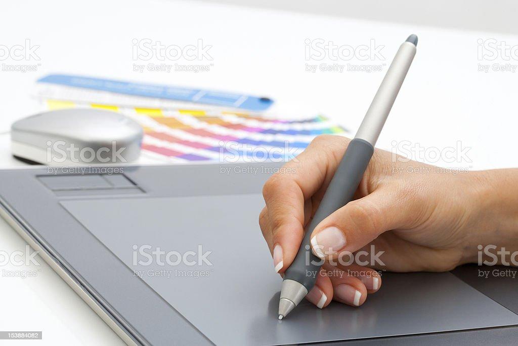 Female hand using pen on digital tablet. stock photo